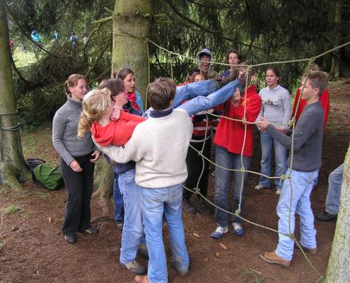Spinnenweb tijdens een training en teambuilding in de Ardennen