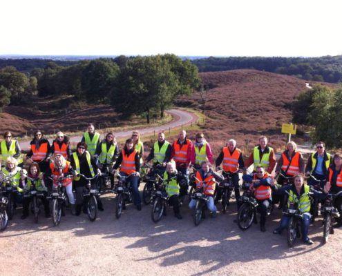 Solex Tour groepsfoto tijdens een uitje in Gelderland